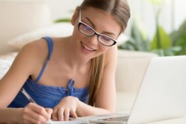 Young lady decoding on the laptop learning languages by birkenbihl approach